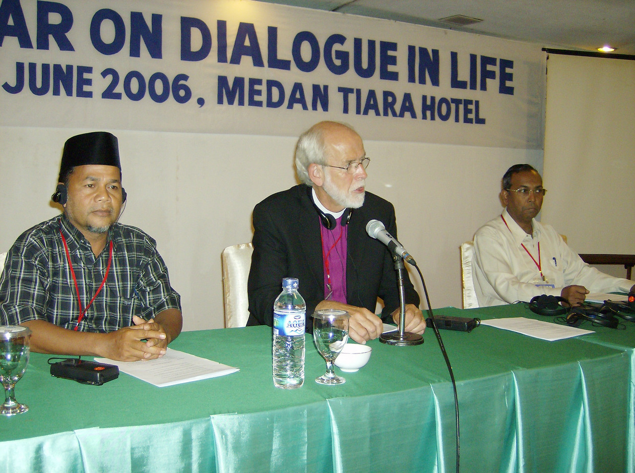 The Rev. Mark S. Hanson, ELCA presiding bishop and LWF president, was  flanked June 30 by Muslim (left) and Christian chairs of the LWF Seminar  on Dialogue in Life, Tiara Hotel, Medan, Indonesia.