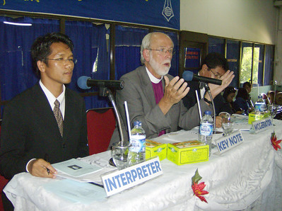 The Rev. Mark S. Hanson (center), ELCA presiding bishop and LWF  president, addressed an audience of more than 300 July 1 at the HKBP's  Nommensen University, Medan, Indonesia.  The Rev. Deonal Sinaga (left),  director, HKBP Office for Ecumenism, Tarutung, Indonesia, translated  Hanson's words into Bahasa Indonesia.