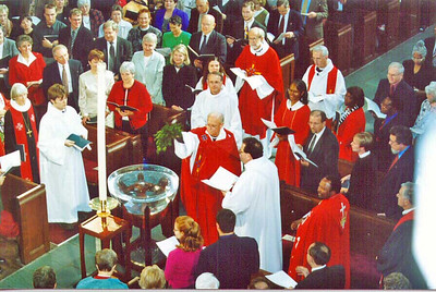 Early in the installation service, the Rev. H. George Anderson, ELCA presiding bishop, sprinkles water on the congregation as part of a renewal of baptismal vows. Anderson will conclude his six-year term Oct. 31.