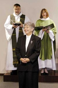 Sister E. Anne Keffer acknowledges the congregation during her installation as directing deaconess, Deaconess Community of the ELCA. The Rev. Raymond L. Schultz, national bishop, Evangelical Lutheran Church in Canada, and the Rev. Rebecca S. Larson, executive director, ELCA Division for Church in Society, participate in the liturgy.