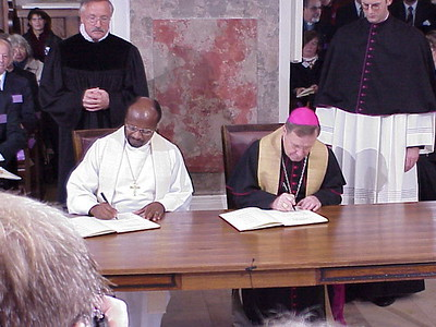 The next to sign the Joint Declaration were General Secretary Noko, left, and Bishop Kasper.