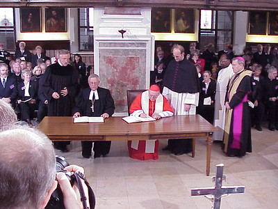 Two sets of documents were presented for signing at the ceremony. One set is for the LWF and the other is for the Vatican. The first to sign were President Krause, left, and Cardinal Cassidy.