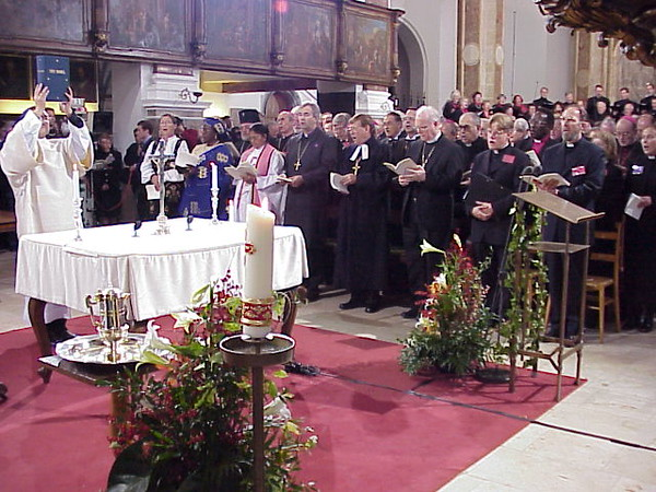 Vice presidents of the LWF listen as the Gospel is presented. With the vice presidents, left of Ishaya and behind the altar's crucifix is Dr. Sigrun Mogedal,  LWF treasurer, lay member, Church of Norway.