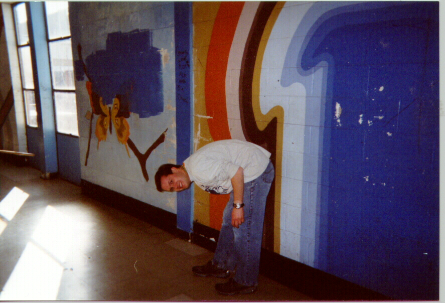 LSM-USA gathering participant removing graffiti at John F. Kennedy High School, New Orleans.