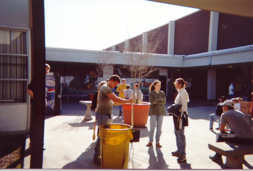 Gathering participants clean the JFK High School courtyard.