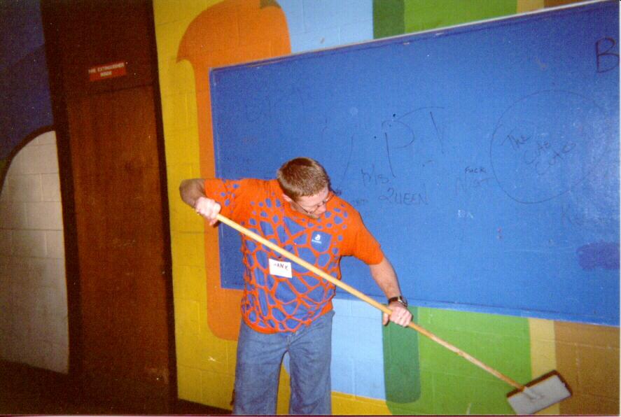 LSM-USA gathering participant removing graffiti Dec. 29, 2000, at John F. Kennedy High School, New Orleans.