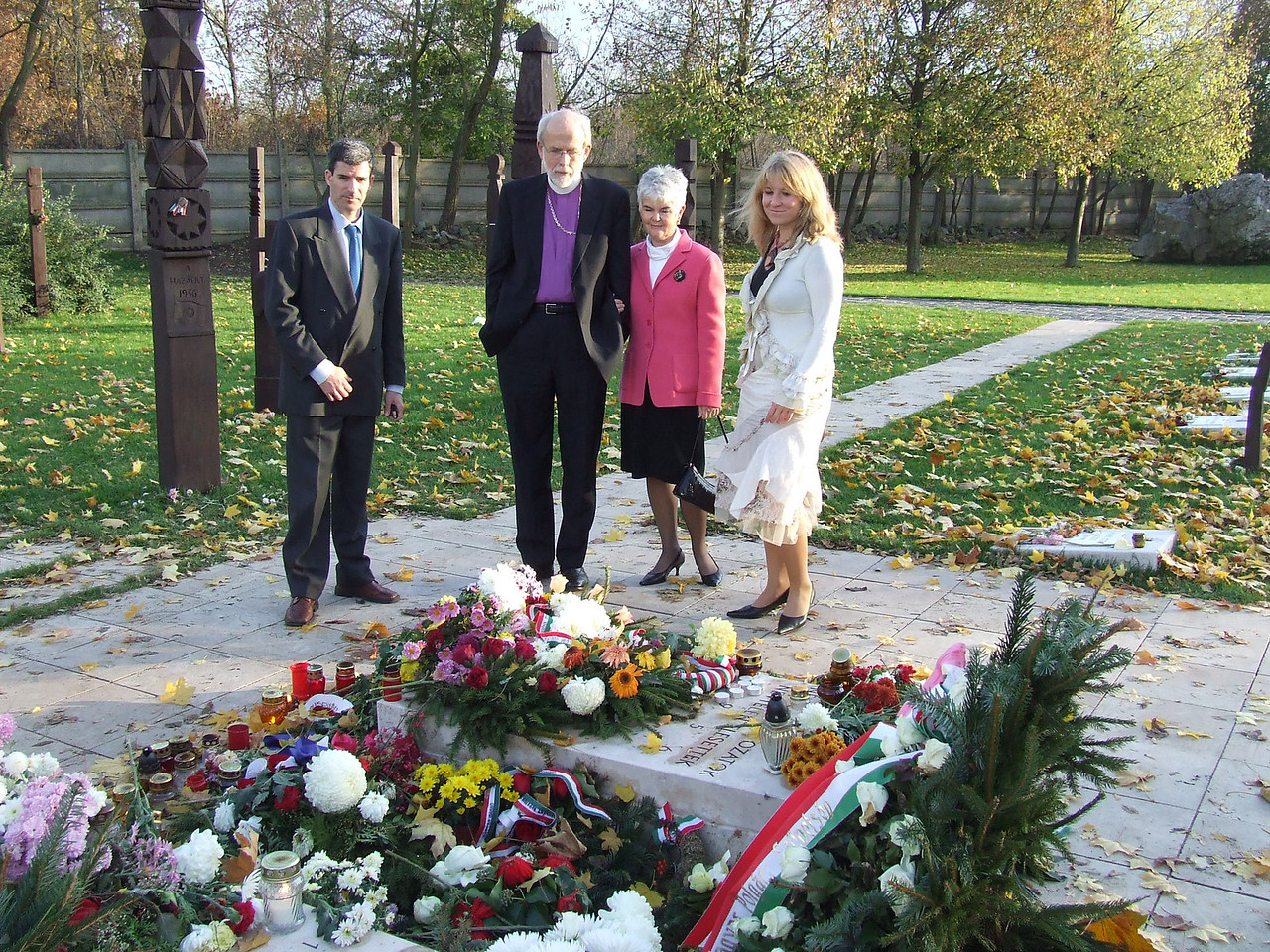 LWF President and ELCA Presiding Bishop Mark S. Hanson, second from left, and his wife, Ione, visit a cemetery in Budapest, where victims of the unsuccessful 1956 coup against the Communist regime, are buried.  With the Hansons, are from left, driver Míklos, and far right, Anna Frenyó, who has youth ministry responsibility for the Evangelical Lutheran Church in Hungary.