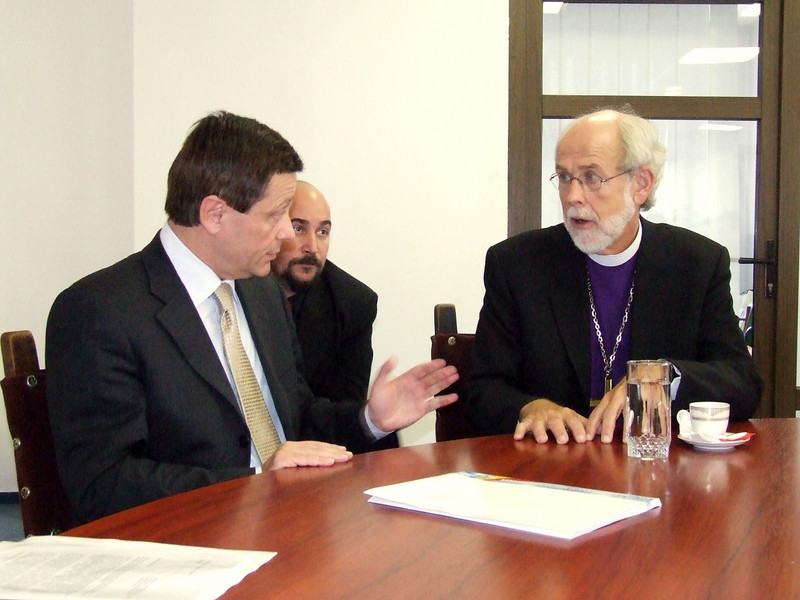 LWF President and ELCA Presiding Bishop Mark S. Hanson, right, makes a point during a discussion with Adrian Iorgulescu, left, of the Romanian ministry of cult and culture.  The two met in Bucharest Oct. 30, during Hanson's formal visit to the Hungarian Lutheran churches