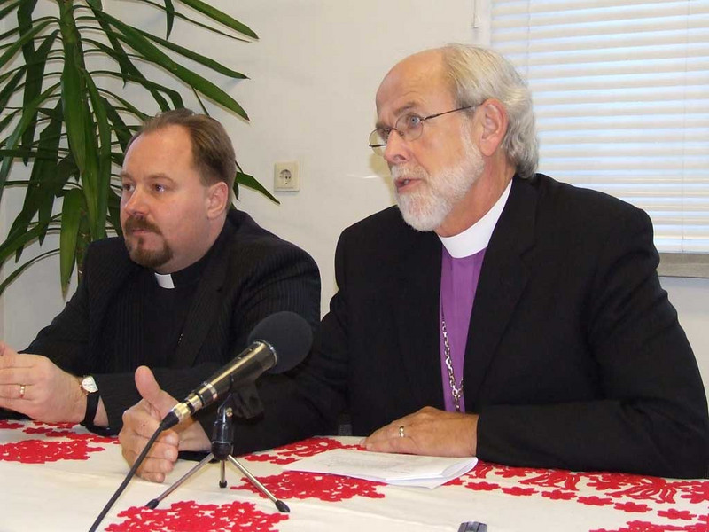 During a news conference in Brasov, Transylvania Oct. 30, LWF President and ELCA Presiding Bishop Mark. S. Hanson responds to a reporter's questions. With him, left, is Bishop Dezso Zoltan Adorjani, of the Evangelical-Lutheran Church in Romania.