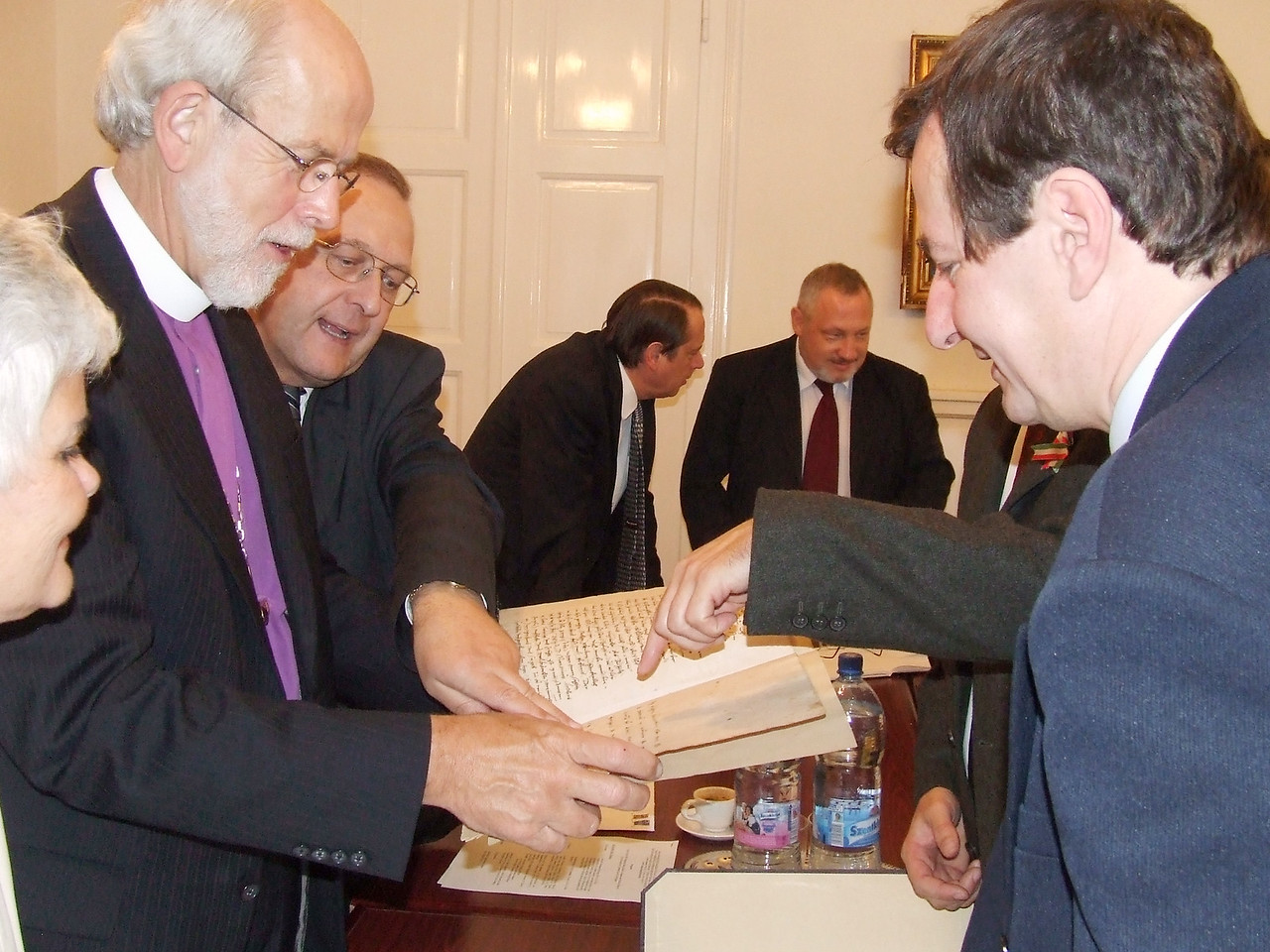 LWF President and ELCA Presiding Bishop Mark S. Hanson views the original copy of the Last Will and Testament of Martin Luther during his visit to Budapest, Hungary on Oct. 26.  The document was given as a gift to the Lutheran Church in Hungary in the early 1800s.  With Hanson are, from left, Ione Hanson, Bishop János Ittzés, interim presiding bishop of the Evangelical Lutheran Church in Hungary, and Dr. Péter Szentpétery, senior lecturer, Lutheran Theological University, Budapest.