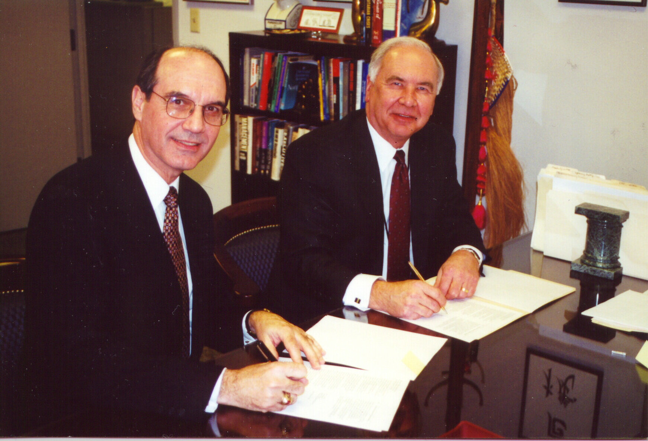 """The Rev. Gilbert B. Furst (right) director for Lutheran Disaster Response, and John A. Clizbe, vice president for disaster services, Red Cross, sign the """"Statement of Understanding"""" between the American Red Cross and Lutheran Disaster Response on Jan. 17, in Washington, D.C."""