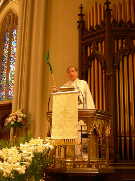 Archbishop Fred Hiltz of the Anglican Church of Canada holds up a shovel to make a point about cooperative work of his church and the Evangelical Lutheran Church in Canada.