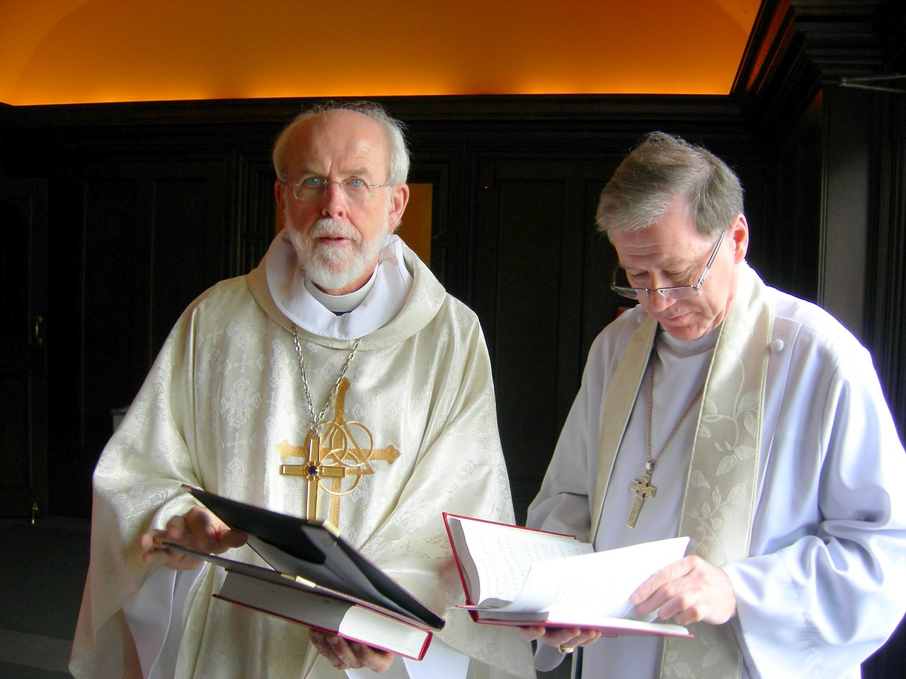 Presiding Bishop Mark Hanson of the Evangelical Lutheran Church in America, left, and Archbishop Fred Hiltz of the Anglican Church of Canada, prepare for the May 1 worship celebration.