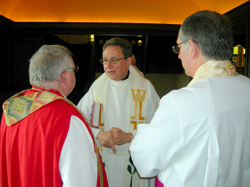 The Rev. Donald J. McCoid, ELCA ecumenical and inter-religious relations executive, center, talks with Bishop J. Michael Garrison, left, Episcopal Diocese of Western New York, prior to the May 1 service.  With them right, is Archdeacon A. Paul Feheley, Anglican Church of Canada.