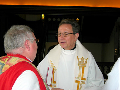 The Rev. Donald J. McCoid, ELCA ecumenical and inter-religious relations executive, right, talks with Bishop J. Michael Garrison, left, Episcopal Diocese of Western New York, prior to the May 1 service.