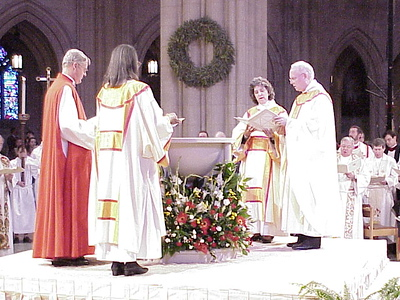 Griswold, Butler, Campbell and Anderson (left to right) gathered around a baptismal font to affirm the churches' mutual recognition of Baptism.