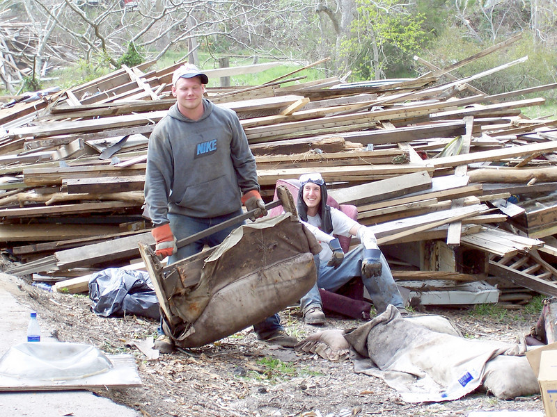 Two university students spend their spring break cleaning up debris left behind from Hurricane Katrina. They are participating in 'What a Relief', an opportunity for students and others in campus communities to help survivors of the 2005 hurricane season recover.
