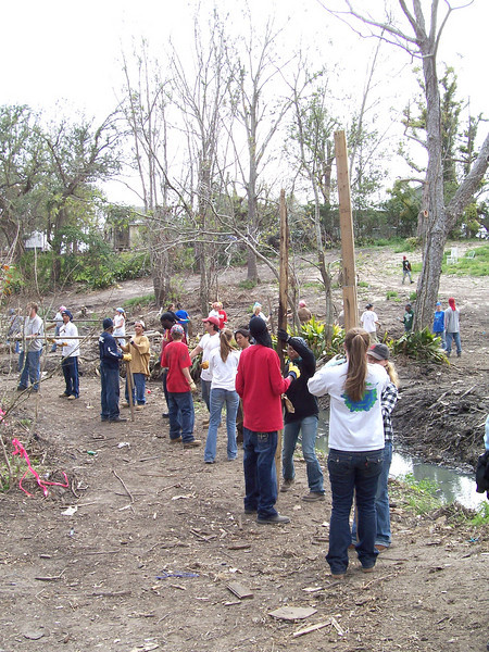 College and university students form an assembly line to remove debris left behind from Hurricane Katrina. They are participating in 'What a Relief', an opportunity for students and others in campus communities to help survivors of the 2005 hurricane season recover.