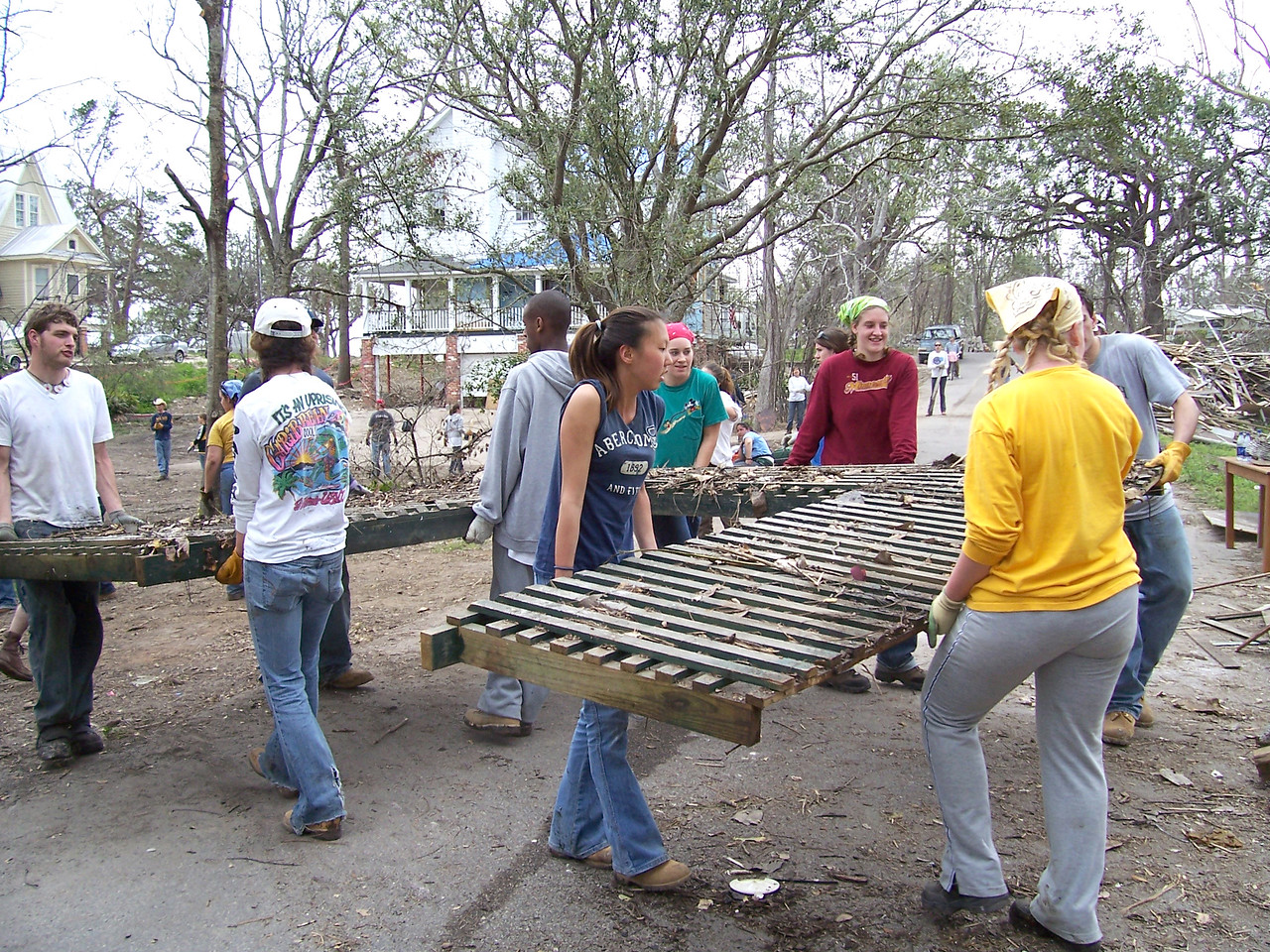 College and university students team-up to remove heavy debris left behind from Hurricane Katrina. They are participating in 'What a Relief', an opportunity for students and others in campus communities to help survivors of the 2005 hurricane season recover.