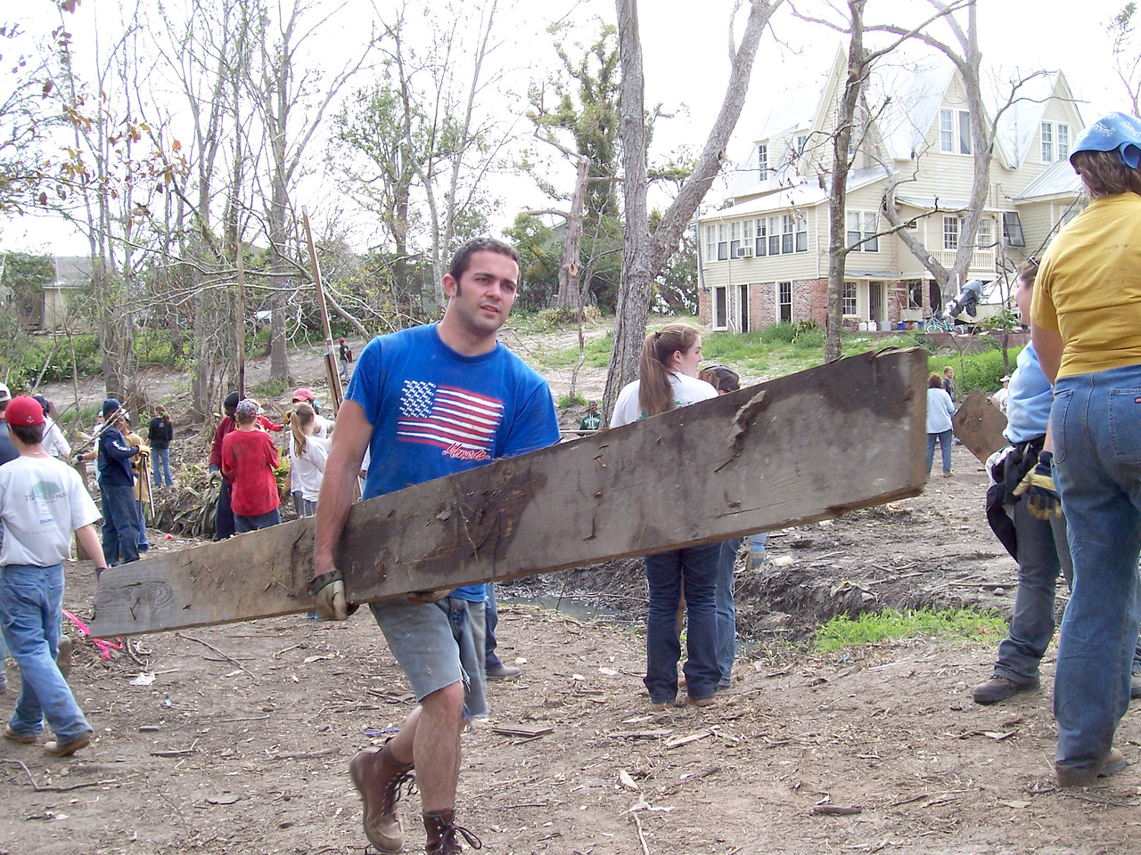A university student spends his spring break clearing up debris left behind from Hurricane Katrina. He is participating in 'What a Relief', an opportunity for students and others in campus communities to help survivors of the 2005 hurricane season recover.