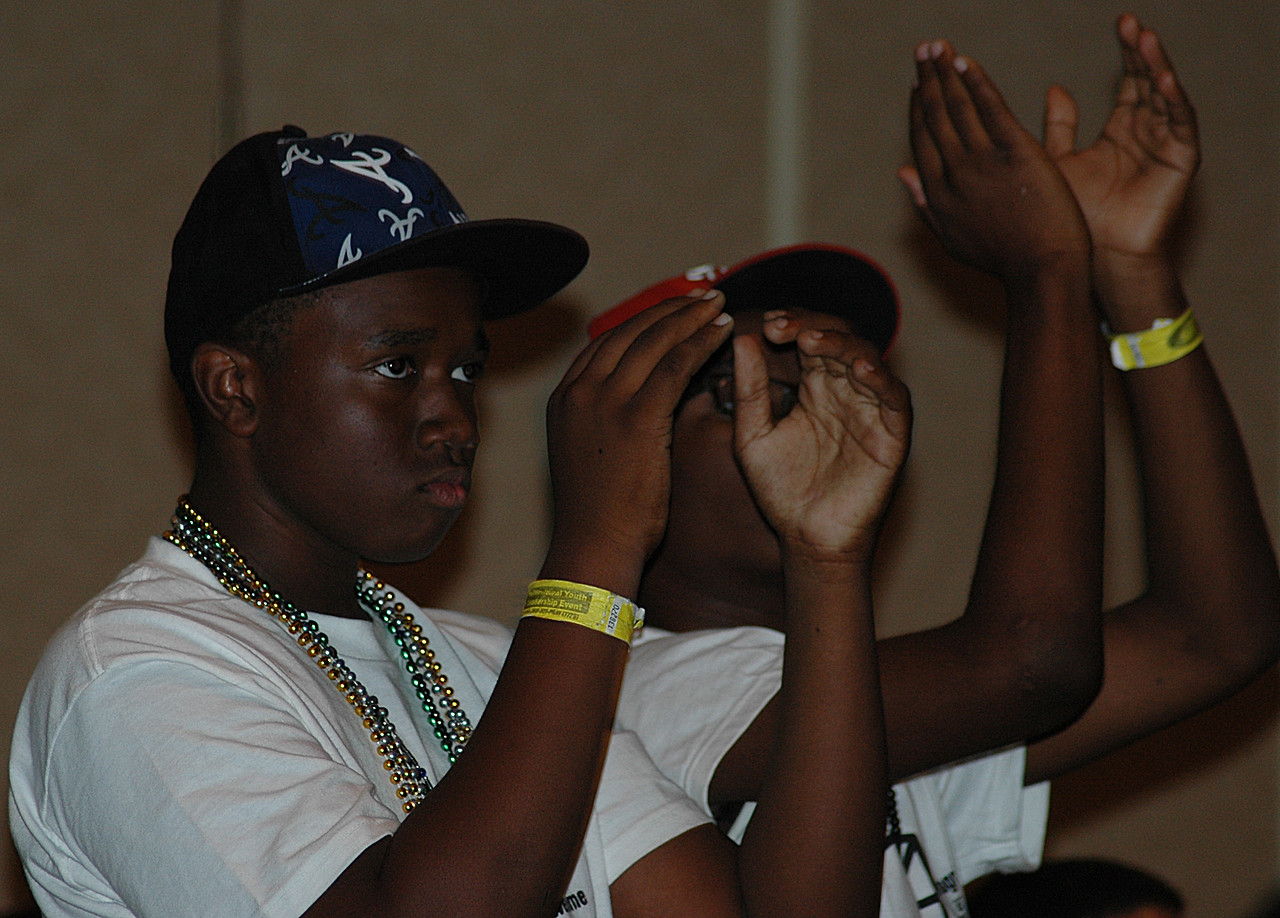"Two MYLE participants applaud a speaker during the ""What's Color Got to Do with It?"" learning session of the event. (Carrie Draeger, 2009)"