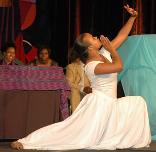 Apu Seyenkulo, Chicago poses near the end of an interpretive dance at the 2009 MYLE in New Orleans, La. as Mason and the Rev. Linda Norman, Chicago, who served as chaplains for the event, look on. (Carrie Draeger, 2009)