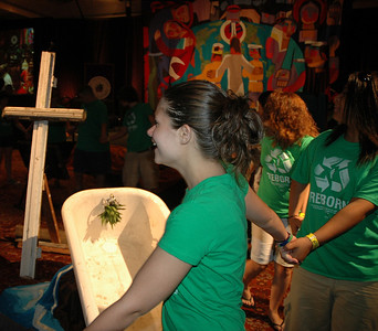Teens dance around the baptismal font during worship Tuesday night at the 2009 MYLE. (Carrie Draeger, 2009)