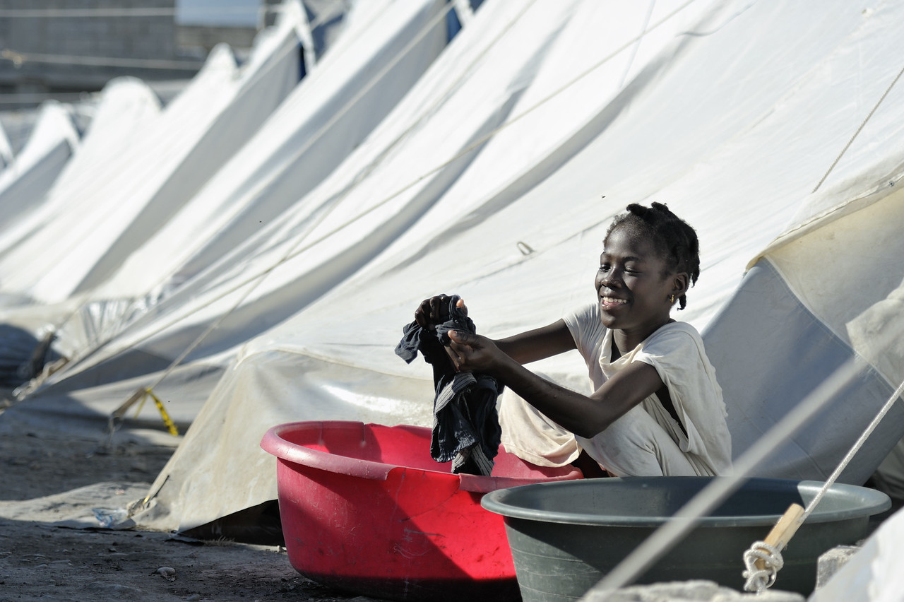 Sentia Fabien, a 10-year old survivor of Haiti's devastating January 12 earthquake, washes laundry outside her family's tent in a displaced person's camp in the Belair section of Port-au-Prince. The tents and other support for the camp have been provided by the ACT Alliance. Photo by Paul Jeffrey/ACT Alliance