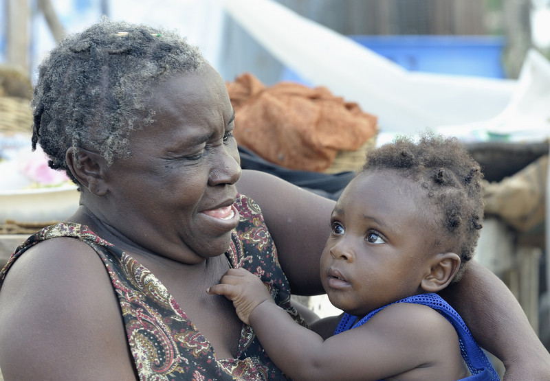 A woman in Dabonne, Haiti, plays with a child in a temporary shelter. The family was left homeless by a January 12 earthquake. Photo by Paul Jeffrey/ACT Alliance.