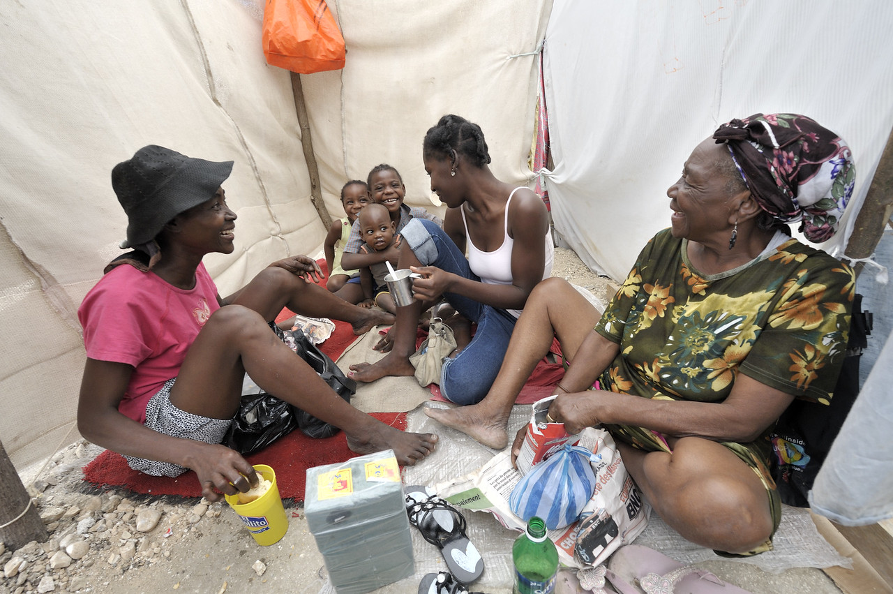 This family is among hundreds of earthquake survivors huddled in tents and makeshift shelters in a soccer stadium in the Santa Teresa area of Petionville, Haiti. They have named the narrow passages between their shelters with street names. Hundreds of thousands of Haitians were left homeless by the January 12 quake. The ACT Alliance is providing water and other services to this community. Photos by Paul Jeffrey/ACT Alliance.
