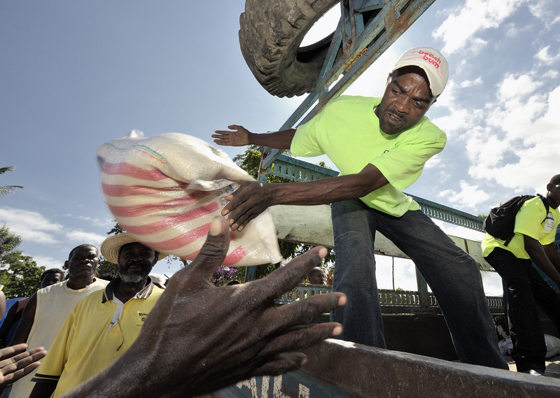 Relief aid is unloaded in Jacmel, a town on Haiti's southern coast that was ravaged by the January 12 earthquake. A portion of the aid was airlifted to the region by Diakonie, a member of the ACT Alliance. Photo by Paul Jeffrey/ACT Alliance.