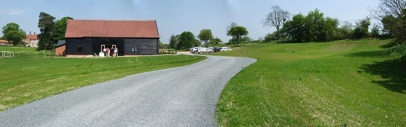 The Medieval Barn after renovation works, seen within the setting of Bruisyard Hall and the new grounds that are still to be planted.