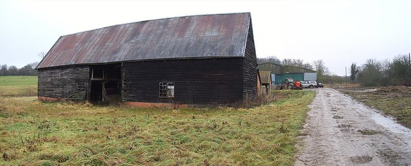 The derelict Medieval Barn before restoration.