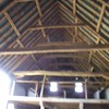 The internal beams of the derelict Medieval Barn, before restoration.
