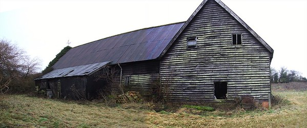 The derelict Medieval Barn before restortion.