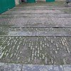 The existing coach house stone runners, that were in need of renovation.