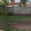 The existing lawn - badly damaged by dogs, with overlooking from neighbours, into the sunroom and garden.