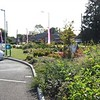 Image of the Littleport BP Garage, post development with new, floristic style, landscape scheme.