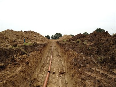 Installation of sub-liner ground drainage to prevent the build-up of water below the lining membranes.