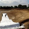 The geotextile membrane is laid across the base of the lake, looking east from the edge of garden.