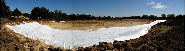 The geotextile membrane is laid across the base of the lake, looking north.