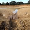 Lake accumulating rainfall water post excavation, showing a need for sub base drainage.