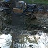 DURING: Excavation works during wet weather meant a battle against the rain and puddling at the base of the pond.