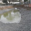 DURING:   The pond liner has been compacted and now water is reintroduced from lorries, under licence.