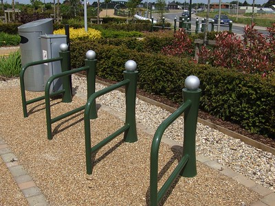 """Photographs of the completed scheme with ELD bespoke design cycle stands, called """"The Fathom""""."""