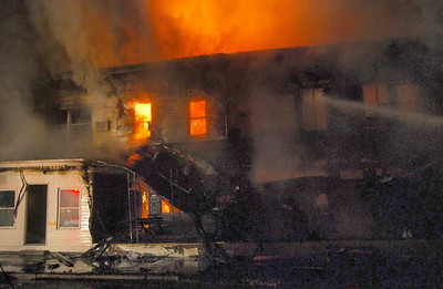 Flames shoot from homes in the 500 block of Howard Street in Frackville early Sunday morning.