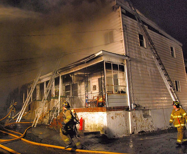 Smoke pours from homes in the 500 block of Howard Street in Frackville early Sunday morning.