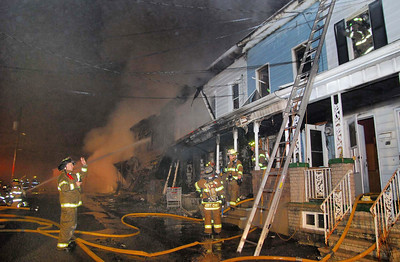 Firefighters battle a blaze that destroyed at least houses in the 500 block of Howard Street in Frackville early Sunday morning.