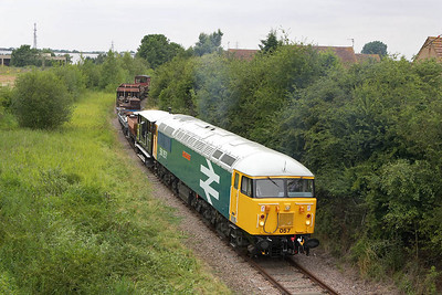 56057 is pictured at London Road, Old Fletton on 22/07/2005. At this point the train is only a couple of hundred yards from the ECML.