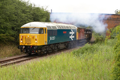Yet another smokey performance as 56057 undertakes its first run past at London Road, Old Fletton on 22/07/2005.